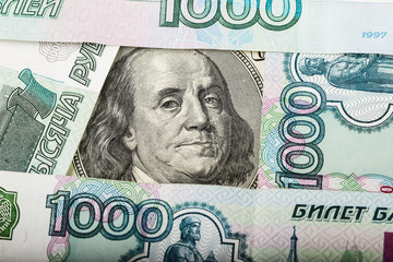 Hundred dollars and Russian banknotes