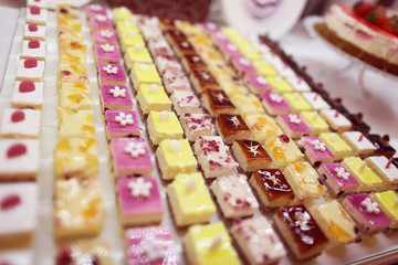 Many colorful small cakes
