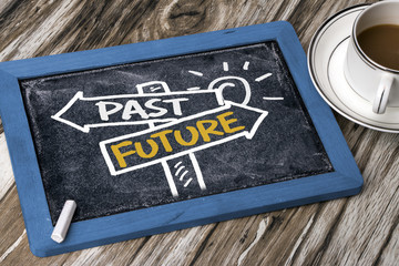 past or future on signpost hand drawing on blackboard