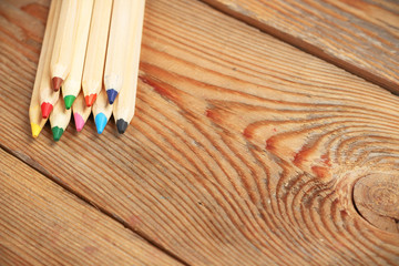 Pencils on a wooden table