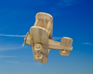 Wooden plane on a blue sky