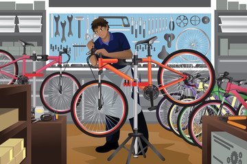 Bike repairman repairing a bicycle in his shop