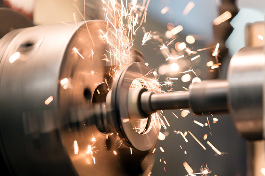 Finishing metal working on lathe grinder machine with sparks