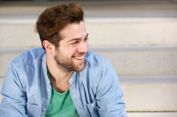 Modern young man with beard smiling