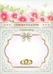 Wedding card with rings on a background with flowers