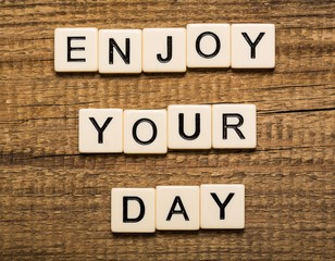 Monday. Tablet pc with text Enjoy Your Day with bokeh background