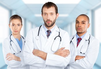 Doctor. Doctors Standing Outside A Hospital