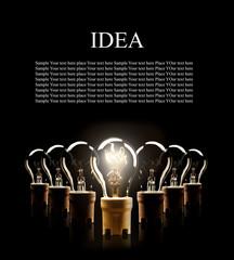 Light bulbs in row with single one shinning
