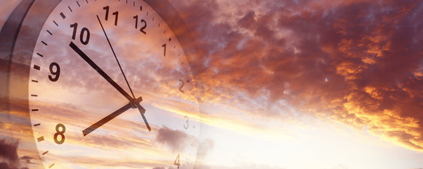 Time passing. Clock in sky