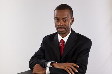 Black businessman thinking