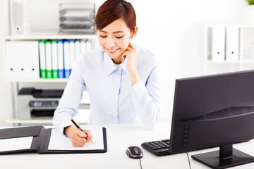 young  business woman working in the office