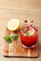 cold red soft drink from raspberry syrup and mint