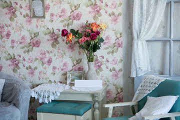 Interior room with chairs, pillows, door and flowers
