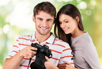 Camera. Summer holidays and dating concept - smiling couple with