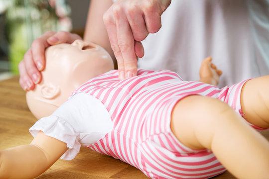 Infant CPR two finger cvompression
