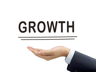 growth word holding by businessman's hand