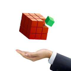 businessman's hand holding magic cube
