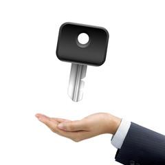 businessman's hand holding a key