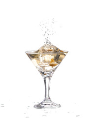 A martini glass on a white background; the water ripples
