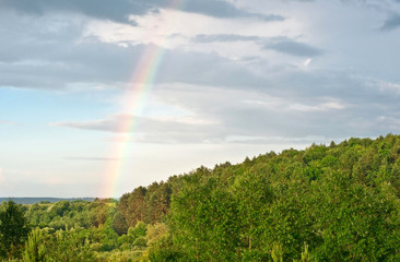 Rainbow in the dark sky.