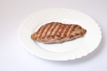 Grilled beef steak on plate