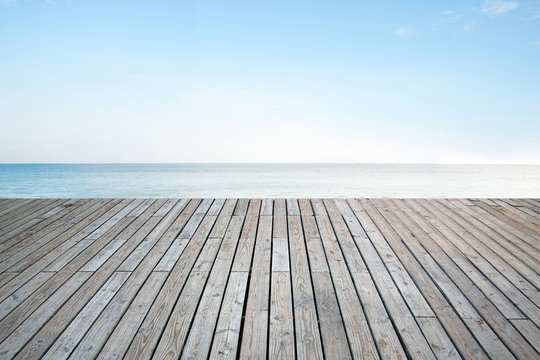 Old vertical striped wooden terrace with sky sea