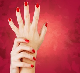 Nail. Closeup photo of a beautiful female hands with red nails