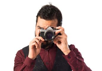 Man wearing waistcoat photographing