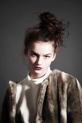 fashion woman in  brown fur coat pose