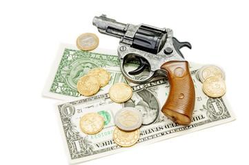 Revolver and money on white background