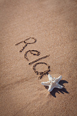 relax drawing on beach. Summer concept with starfish on sands.