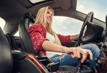 Young woman drive a car