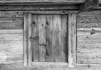 Wooden door into ancient rustic barn