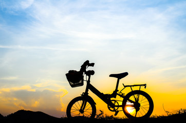 Bicycle silhouette with sun set.