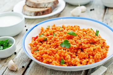 millet porridge with tomato sauce, garlic and parsley