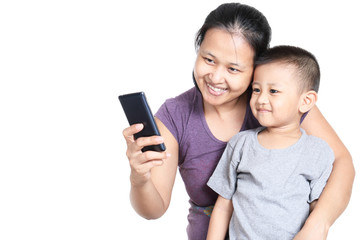 Mother and son selfie themselves by mobile phone