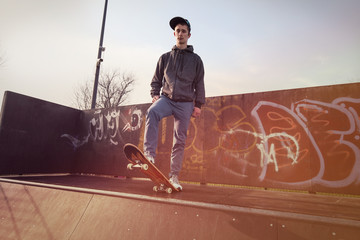 Young man standing on a skateboard