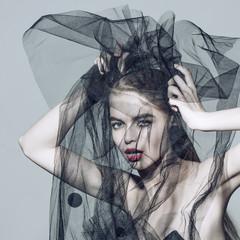 Fashion beautiful woman under the black veil