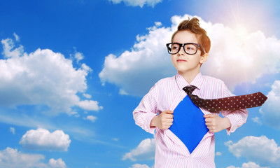 boy secret super heroon blue sky background