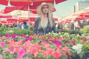 Attractive blonde girl with straw hat.