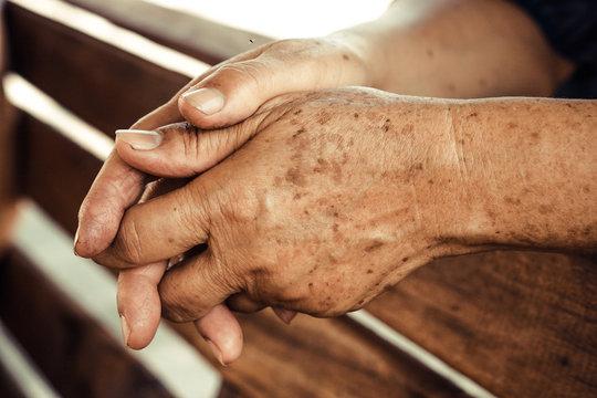 hands of a female elderly full of freckles