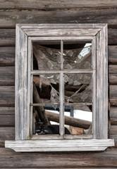 window of an abandoned house