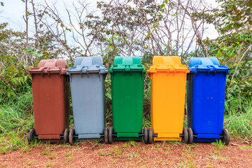 Colorful trashes for recycling container ecology concept