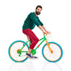 Man on colorful bike