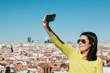 Young Woman Taking a Selfie from a City Viewpoint