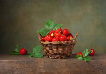 Still life with strawberries in a basket