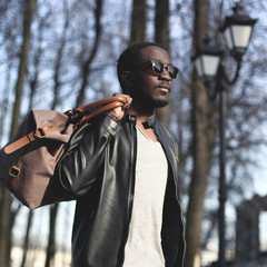 Fashion portrait of handsome african man in black leather jacket