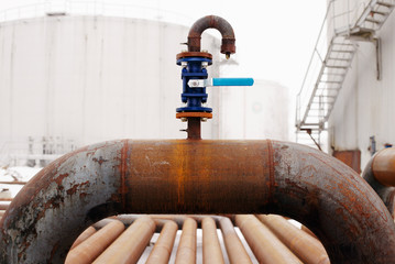 blue valve on rusty piping