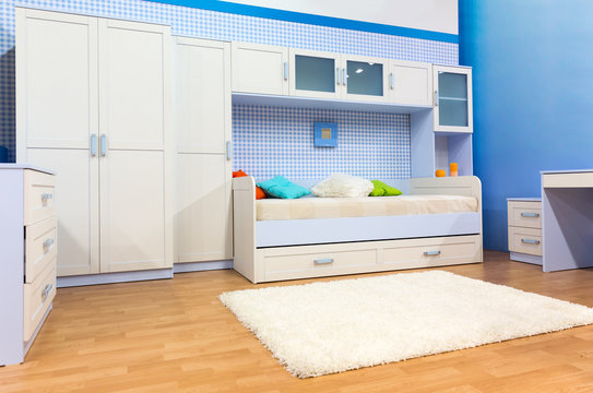 Bright bedroom with a bed and cupboard
