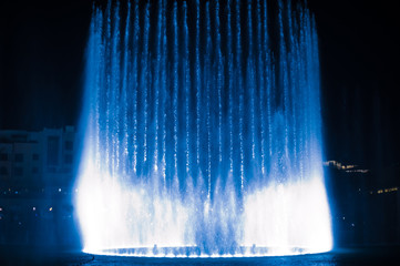 beautiful dancing fountain illuminated at night